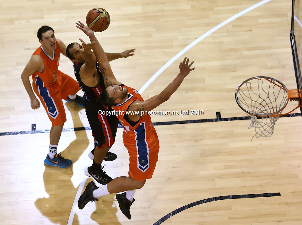 Marques Whippy (L) of the Rams and James Paringatai compete for the ball in the NBL basketball match between the Southland Sharks and Canterbury Rams, ILT Stadium Southland, Invercargill, Saturday, April 16, 2016. Photo: Dianne Manson / www.photosport.nz