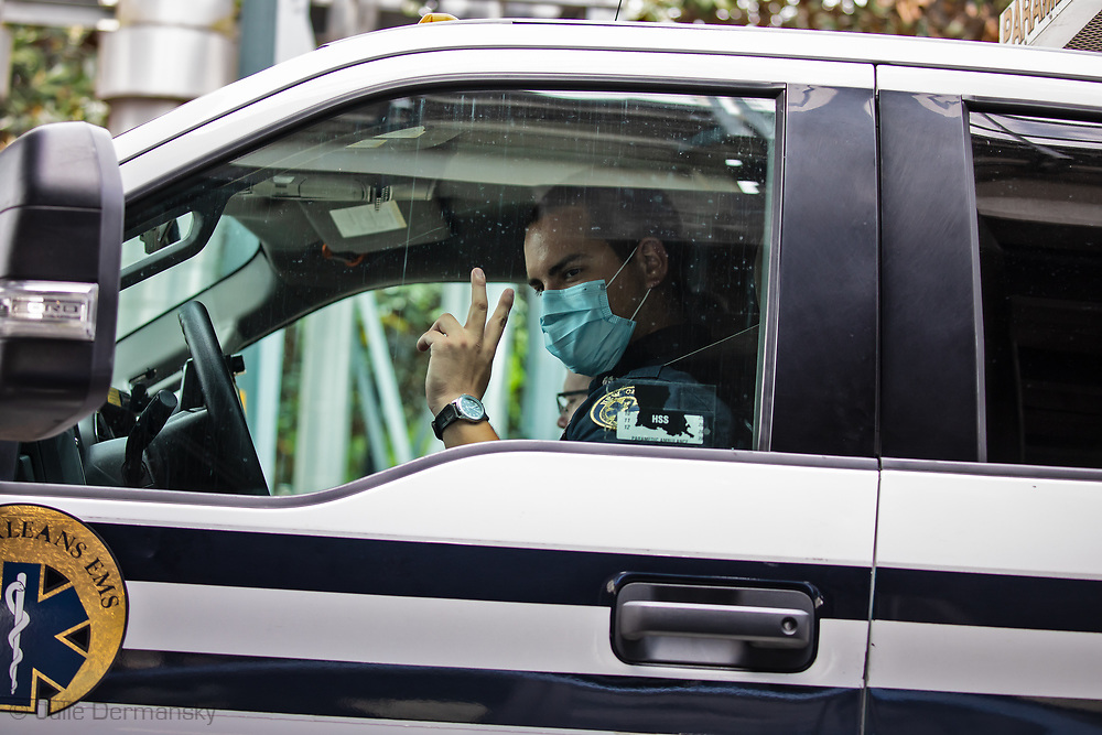 New Orleans,  April 4, 2020,  ETM worker wearing a mask in an ambualnce, as the Coronavirus continues to spread globaly.