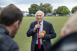 © Licensed to London News Pictures. 28/04/2017. London, UK. Liberal Democrat Vince Cable adjusts his tie as he poses for a photograph during his campaign launch on Twickenham Green in a bid to return to Parliament.  Photo credit: Peter Macdiarmid/LNP