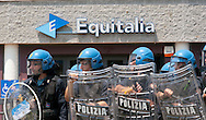 Roma 26 Maggio 2011.Manifestazione di precari, studenti e senza casa davanti alla Gerit Equitalia di viale Palmiro Togliatti, (Agente della Riscossione), con lancio di ortaggi e petardi verso l'edificio della Gerit e le Forze dell'Ordine schierate davanti all'ingresso, per protestare per i pignoramenti per le multe non pagate.<br />
