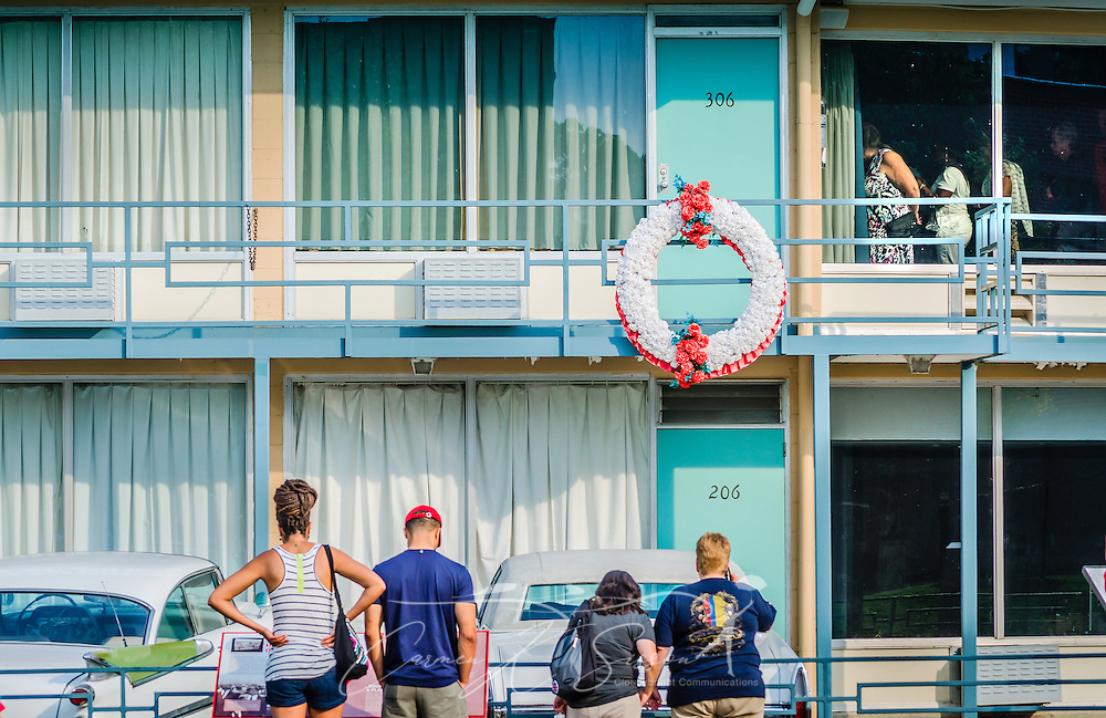 Visitors tour the Lorraine Motel, Sept. 7, 2015, in Memphis, Tennessee. Civil rights leader Dr. Martin Luther King, Jr., was shot and killed at the motel on April 4, 1968, while standing on the balcony. The motel is now part of the National Civil Rights Museum complex. during the segregation era, the Lorraine Motel was one of the few motels that permitted black clientele. The wreath is a replica of one placed previously and marks the spot where King was standing when he was killed. The cars have no historical significance other than to represent the time period, though King often traveled in a white Cadillac when in Memphis. (Photo by Carmen K. Sisson/Cloudybright)