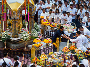 09 NOVEMBER 2017 - BANGKOK, THAILAND: People make offerings to the Erawan Shrine on the 61st anniversary of the shrine's dedication. The Erawan Shrine is one of the most popular shrines in Bangkok. It was dedicated on November 9, 1956, after a series of construction accidents at what was then the Erawan Hotel (since torn down and replaced by the Grand Hyatt Erawan Hotel). The statue in the shrine is Phra Phrom, the Thai representation of the Hindu god of creation Brahma. It is a Hindu shrine popular with Thai and Chinese Buddhists because it is thought that making an offering to the Phra Phrom will bring good fortune.    PHOTO BY JACK KURTZ