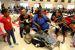 October 7, 2016 - Clearwater, Florida, U.S. - From left: family members BRIANA JEUNICE, 7, VERNEA JONES, 30, GREG JONES III, 18-mos, GREG JONES SR., 36, and ZAHAVA ALEXANDER, 7, settle into the Red Cross shelter at the Samuel S. Gaines Academy building in Fort Pierce as hurricane Matthew swept Florida's east coast. (Credit Image: © Douglas R. Clifford/Tampa Bay Times via ZUMA Wire)
