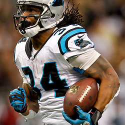December 30, 2012; New Orleans, LA, USA; Carolina Panthers running back DeAngelo Williams (34) runs for a touchdown against the New Orleans Saints during the second half of a game at the Mercedes-Benz Superdome. The Panthers defeated the Saints 44-38. Mandatory Credit: Derick E. Hingle-USA TODAY Sports