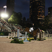 Paige Johnson, USA, riding Dakota, in action during the $210,000 Central Park Show Jumping Grand Prix held in the Wollman Ice Rink. The event was part of the four Day Central Park Horse Show. Central Park, Manhattan, New York, USA. 18th September 2014. Photo Tim Clayton