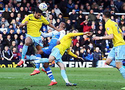 Coventry City's Dominic Samuel under pressure from Peterborough United's Kgosi Ntlhe - Photo mandatory by-line: Joe Dent/JMP - Mobile: 07966 386802 - 28/03/2015 - SPORT - Football - Peterborough - ABAX Stadium - Peterborough United v Coventry City - Sky Bet League One