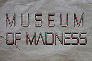 Graphic display of the phrase Museum of Madness for those that feel life is full of MADNESS