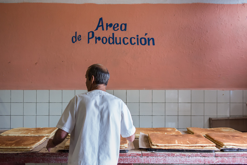 A spongy sweet cake being produced in a bakery in Vinales, in the west of Cuba. 2015