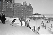 Ski piste and ice skating rink at the Chateau Frontenac, photograph, 1959, from the Archives of the Chateau Frontenac, Quebec City, Quebec, Canada. The Chateau Frontenac opened in 1893 and was designed by Bruce Price as a chateau style hotel for the Canadian Pacific Railway company or CPR. It was extended in 1924 by William Sutherland Maxwell. The building is now a hotel, the Fairmont Le Chateau Frontenac, and is listed as a National Historic Site of Canada. The Historic District of Old Quebec is listed as a UNESCO World Heritage Site. Copyright Archives Chateau Frontenac / Manuel Cohen