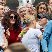 2019 US Open Tennis Tournament- Day Thirteen.    Bianca Andreescu of Canada hugs her team watched by father Nicu and mother Maria after her victory against Serena Williams of the United States in the Women's Singles Final on Arthur Ashe Stadium during the 2019 US Open Tennis Tournament at the USTA Billie Jean King National Tennis Center on September 7th, 2019 in Flushing, Queens, New York City.  (Photo by Tim Clayton/Corbis via Getty Images)