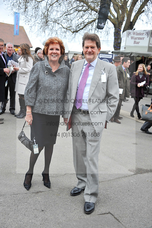 CILLA BLACK and SIR JOHN MADEJSKI at the Hennessy Gold Cup at Newbury Racecourse, Berkshire on 26th November 2011.