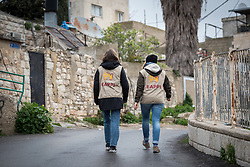 29 February 2020, Jerusalem: Ecumenical Accompaniers Kristin (left) and Charlotte (right) walk through the neighbourhood of Sheikh Jarrah in East Jerusalem. While a predominantly Palestinian neighbourhood, Sheikh Jarrah is under constant pressure from Israeli settler movements looking to push Palestinian families out and take over the area.