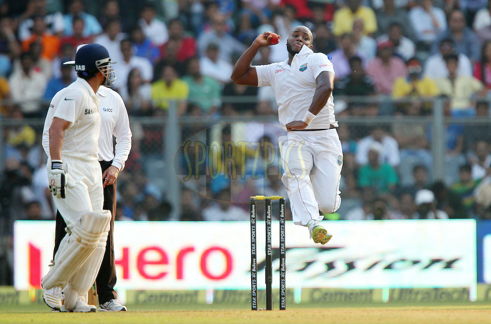 Tino Best of West Indies  during day one of the second Star Sports test match between India and The West Indies held at The Wankhede Stadium in Mumbai, India on the 14th November 2013<br /> <br /> This test match is the 200th test match for Sachin Tendulkar and his last for India.  After a career spanning more than 24yrs Sachin is retiring from cricket and this test match is his last appearance on the field of play.<br /> <br /> <br /> Photo by: Ron Gaunt - BCCI - SPORTZPICS<br /> <br /> Use of this image is subject to the terms and conditions as outlined by the BCCI. These terms can be found by following this link:<br /> <br /> http://sportzpics.photoshelter.com/gallery/BCCI-Image-Terms/G0000ahUVIIEBQ84/C0000whs75.ajndY