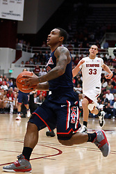 February 3, 2011; Stanford, CA, USA;  Arizona Wildcats guard Lamont Jones (12) dribbles past Stanford Cardinal forward Dwight Powell (33) on a fast break during the second half at Maples Pavilion.  Arizona defeated Stanford 78-69.