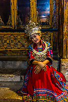 Woman wearing Miao minority native costume, Dayan (Old Town), Lijiang, Yunnan Province, China.