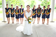 Bride and her bridesmaids showing off their wedding bouquets made of sunflowers at Emerson Park Pavilion, Auburn, NY