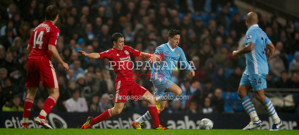MANCHESTER, ENGLAND - Wednesday, January 11, 2012: Liverpool's Stewart Downing in action against Manchester City's Samir Nasri during the Football League Cup Semi-Final 1st Leg at the City of Manchester Stadium. (Pic by David Rawcliffe/Propaganda)