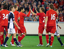 MELBOURNE, AUSTRALIA - Wednesday, July 24, 2013: Liverpool's Luis Suarez celebrates setting up the second goal against Melbourne Victory with team-mate Lucas Leiva during a preseason friendly match at the Melbourne Cricket Ground. (Pic by David Rawcliffe/Propaganda)