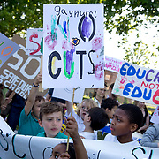London Fields, Hackney. Protest against government plans to cut over 600 teachers in Hackney. A young girl heads a march around the park with a sign saying 'Gayhurst, No Cuts'. (photo by Jenny Matthews/In Pictures via Getty Images)
