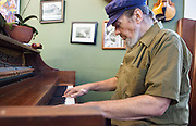 Brad Wilkins' Oak Street Cafe celebrates five years; Dr. John (Mac Rebennack) performs on piano