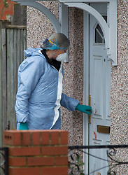 ©Licensed to London News Pictures 26/02/2020<br /> Croydon, UK. A forensics officer using a blood stained front door. A 24 year old man has been stabbed to death in Croydon, South East London over night. Police were called to the scene at 12.15am. The man was pronounced dead at the scene no arrests have been made. A police cordon is in place with forensic officers coming and going to a nearby property. Photo credit: Grant Falvey/LNP