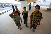 Alamin Hasan with fellow very young child porters on the platform of the Kamalapur Railway Station in Dhaka, Bangladesh. (Featured in the book What I Eat: Around the World in 80 Diets.) MODEL RELEASED.