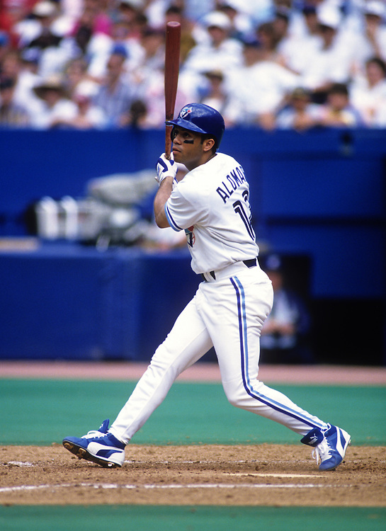 TORONTO - 1994  Roberto Alomar of the Toronto Blue Jays bats during an MLB game at Skydome in Toronto, Ontario.  Alomar played for the Blue Jays from 1991-1995.  (Photo by Ron Vesely)
