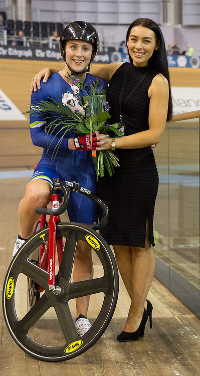 Laura Trott (Matrix Fitness) receives her flowers after winning the Elimination-Scratch Race - Women.  Revolution 55 Track Cycling Glasgow, 28th November 2015