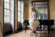 Ballerina-model poses for international photographer in Shipwright House, London.