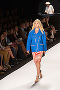 A white skirt with red and orange print, and a bright blue hip-lengh jacket with diagonal zippers.