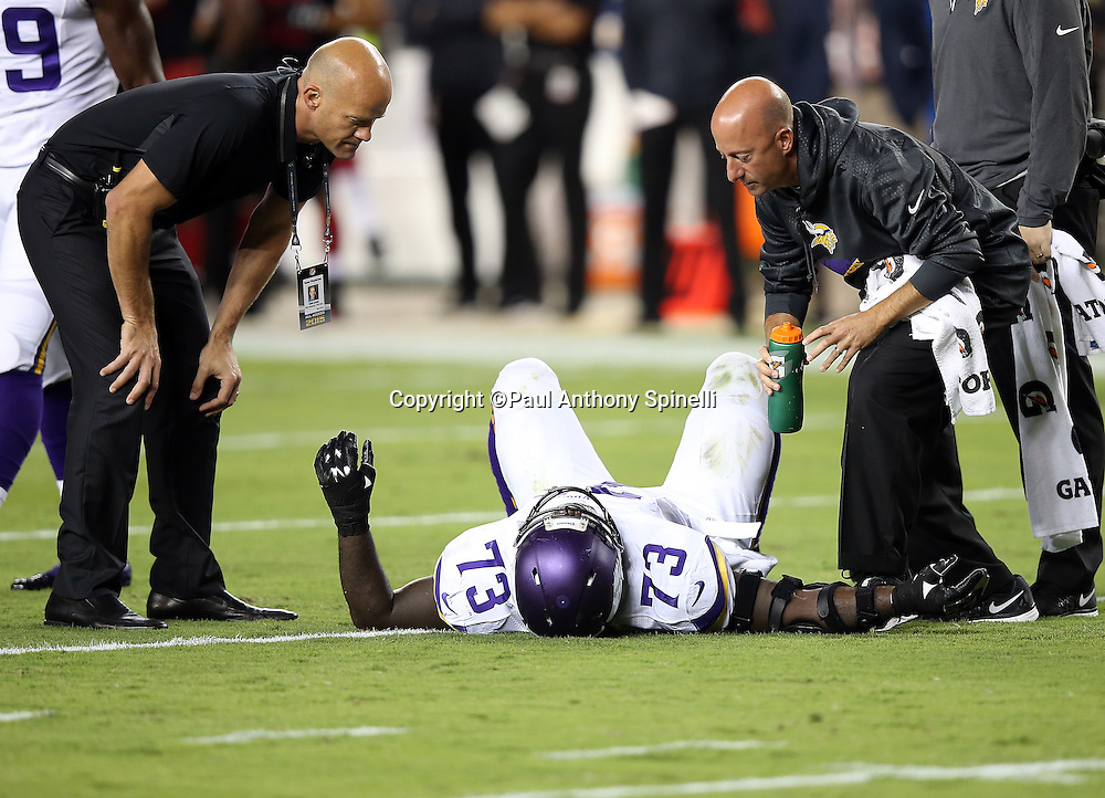 Minnesota Vikings defensive tackle Sharrif Floyd (73) gets medical attention on the field of play during the 2015 NFL week 1 regular season football game against the San Francisco 49ers on Monday, Sept. 14, 2015 in Santa Clara, Calif. The 49ers won the game 20-3. (©Paul Anthony Spinelli)