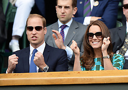 Image licensed to i-Images Picture Agency. 06/07/2014. London, United Kingdom. Duke and Duchess of Cambridge celebrate first set win by Federer in the Royal Box at the Wimbledon Men's Final.  Picture by Andrew Parsons / i-Images