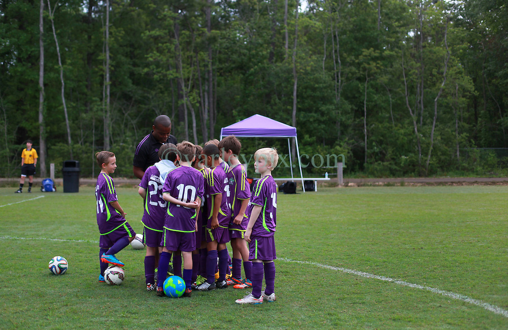 11 April 2015. Hammond, Louisiana.<br /> U9 New Orleans Jesters Elites, team purple prepare for their first game against U10 teams in the Strawberry Cup hosted by the South Tangipahoa Youth Soccer Association (STYSA).<br /> Photo; Charlie Varley/varleypix.com