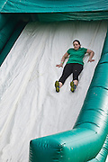 A participant slides down a part of the inflatable obstacle course during the first part of the O'Bleness Race for a Reason Mud Run, Saturday, April 27, 2013. The course included a four-mile run up to the old Army ROTC Course at the Ridges, through the Radar Hill Trail and back to Tail Great Park across from Peden Stadium. Race for a Reason, Race 4 A Reason, Annual Events, Events, Students, Faculty & Staff