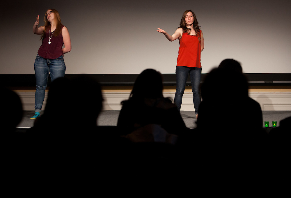 Elizabeth DeLozier, left, and Sarah Scarberry do an expressive sign language performance at the beginning of the Sixth Annual International Women's Day Festival, held in Baker Center Ballroom on March 16, 2014. The event, sponsored in part by the Ohio University Women's Center, educated audiences about women's progress, celebrated women's achievements, and included numerous performances by female members of the Athens and Ohio University community. International Women's Day itself fell on March 8, 2014. Photo by Lauren Pond