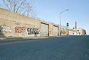 Empty dangerous urban street in Brooklyn, New York City.