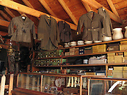 "Jackets and boxes are arrayed in the late 1800s restored Frontier Ladies Dry Goods Store in Nevada City, Montana, USA. Nevada City was a booming placer gold mining camp from 1863-1876, but quickly declined into a virtual ghost town. This fascinating town inspires you to imagination what life must have been like in early Montana when gold was discovered at nearby Alder Gulch. More than 90 buildings from across Montana have been gathered for preservation at Nevada City, mostly owned by the people of the State of Montana, and managed by the Montana Heritage Commission. In 2001, the excellent PBS television series ""Frontier House"" used one of the buildings and its furnishings to train families in re-creating pioneer life. A miner's court trial and hanging of George Ives in the main street of Nevada City was the catalyst for forming the Vigilantes, a group of citizens famous for taking justice into their own hands in 1863-1864. Directions: go 27 miles southeast of Twin Bridges, Montana on Highway 287."
