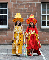 Pictured: Liberty Bramall (light) and Kate Campbell wearing lampshade outfits designed by Liberty Bramall.<br /> <br /> Edinburgh College of Art students held a photo call before their degree show.<br /> <br /> &copy; Dave Johnston / EEm