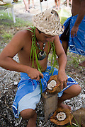 Coconut huskingFakarava, Tuamotu Islands, French Polynesia, (Editorial use only)<br />