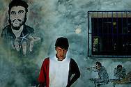 """Ernesto """"Che"""" Guevara left Cuba in 1965 to foment revolution abroad, first unsuccessfully in Congo-Kinshasa and later in Bolivia, where he was captured by CIA-assisted Bolivian forces and summarily executed. This collection depicts ordinary Bolivians that reside in towns where """"El Comandante"""" once travelled."""
