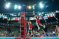 Russia's Sergey Savin spikes the ball while volleyball match between Brazil and Russia during the 2014 FIVB Volleyball World Championships at Spodek Hall in Katowice on September 14, 2014.<br /> <br /> Poland, Katowice, September 14, 2014<br /> <br /> For editorial use only. Any commercial or promotional use requires permission.<br /> <br /> Mandatory credit:<br /> Photo by © Adam Nurkiewicz / Mediasport