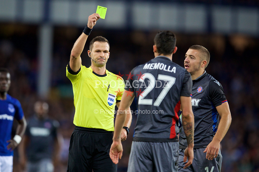 LIVERPOOL, ENGLAND - Thursday, August 17, 2017: Referee Ivan Kružliak shows a yellow card during the UEFA Europa League Play-Off 1st Leg match between Everton and HNK Hajduk Split at Goodison Park. (Pic by David Rawcliffe/Propaganda)