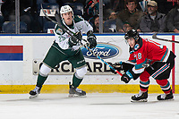 KELOWNA, BC - SEPTEMBER 28:  Wyatte Wylie #29 of the Everett Silvertips is stick checked by Kyle Crosbie #18 of the Kelowna Rockets  at Prospera Place on September 28, 2019 in Kelowna, Canada. (Photo by Marissa Baecker/Shoot the Breeze)