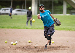 Stan Hellman pitches batting practice as the Montclair softball league celebrates its 50th season, Saturday, April 22, 2017, at Montclair Park in Oakland, Calif. The pickup softball game, played every Saturday by a group of enthusiasts ranging in age from 20 to 75, started in 1968 in Berkeley and moved to Montclair about 25 years ago. (Photo by D. Ross Cameron)