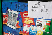 As the UK government considers further restrictions of movement in public places and the continued forced closure of restarants, cafes, gyms and cinemas etc. during the Coronavirus pandemic, a corner shop sells hand gel sanitiser to help the local community stay virus-free, in Brixton, south London, on 23rd March 2020, in London, England.
