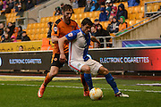 Wolverhampton Wanderers midfielder James Henry holds up Blackburn Rovers midfielder Jason Lowe during the Sky Bet Championship match between Wolverhampton Wanderers and Blackburn Rovers at Molineux, Wolverhampton, England on 9 April 2016. Photo by Alan Franklin.