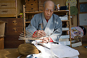 Masao Uyama, 81 makes Boshu Uchiwa fans at his atelier in Tateyama, Chiba Prefecture, Japan on 21 Jan. 2013. Uchiyama has been making the traditional bamboo fans for 63 years. Photographer: Rob Gilhooly