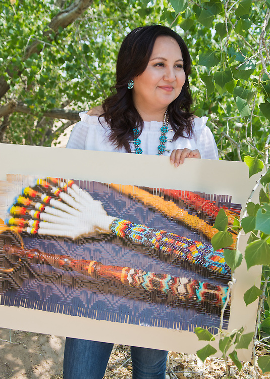 "mkb062817z/arts/Marla Brose --  Tedra Begay, an Albuquerque artist, holds her  photo weaving, ""Harmony"".  (Marla Brose/Albuquerque Journal)"