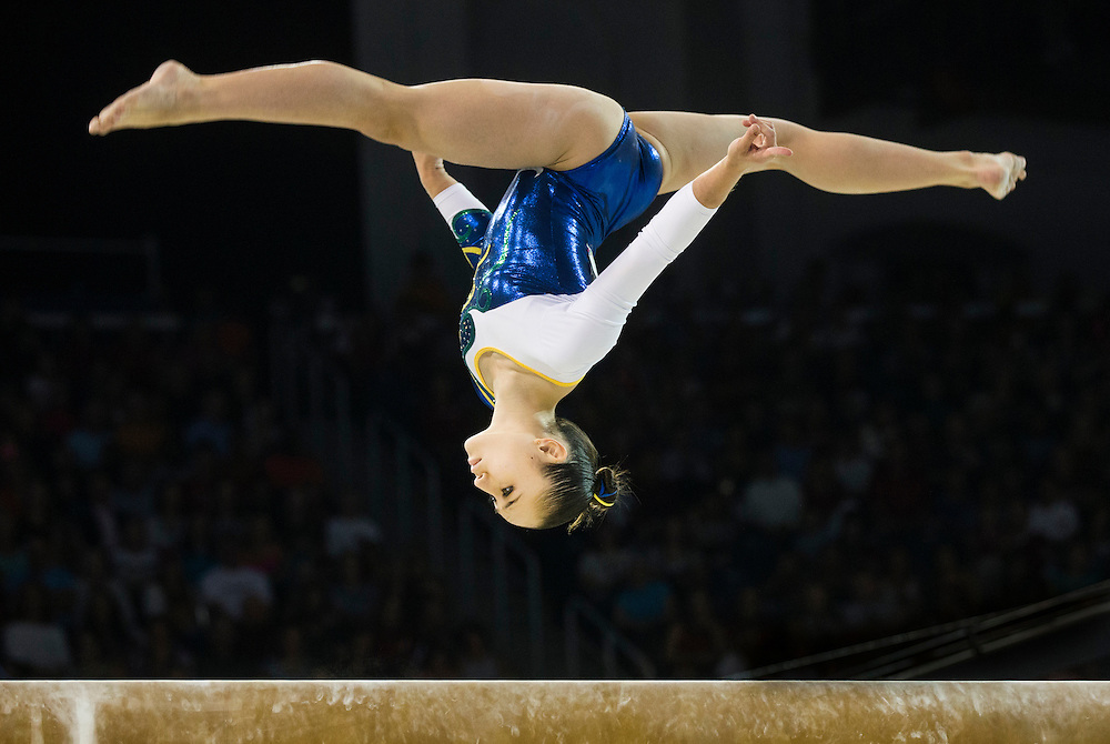 Julie Kim Sinmon of Brazil competes during the artistic gymnastics beam at the Pan Am Games in Toronto, Wednesday July 15, 2015.    THE CANADIAN PRESS/Mark Blinch