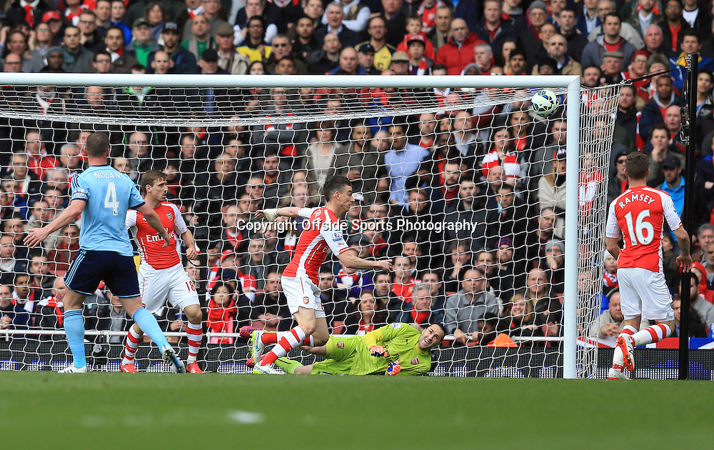14 March 2015 - Barclays Premier League - Arsenal v West Ham - David Ospina of Arsenal makes a save from Kevin Nolan of West Ham with the score a 0-0 - Photo: Marc Atkins / Offside.